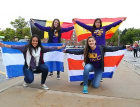 Students holding their home countries flag